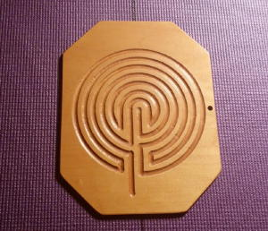 Picture of a Wooden Labyrinth on a Purple Yoga mat
