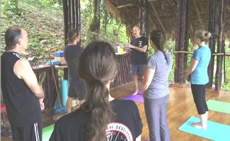 A picture of an asana class at the Kriya Yoga Spiritual Advance in CR