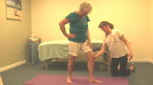 Picture of Lisa putting a client into an Asana Posture