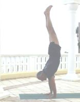 A picture of swami doing a handstand asana